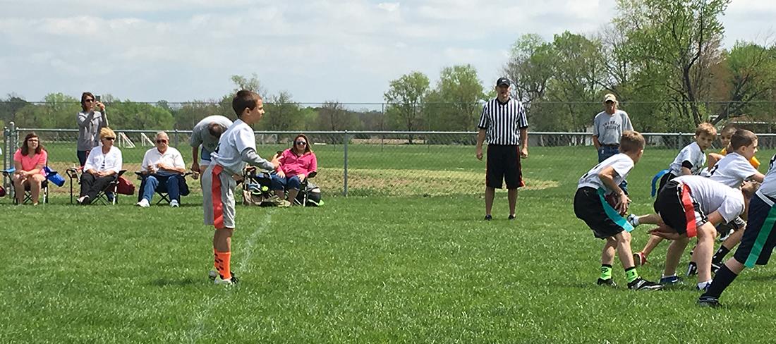 youth boy playing football